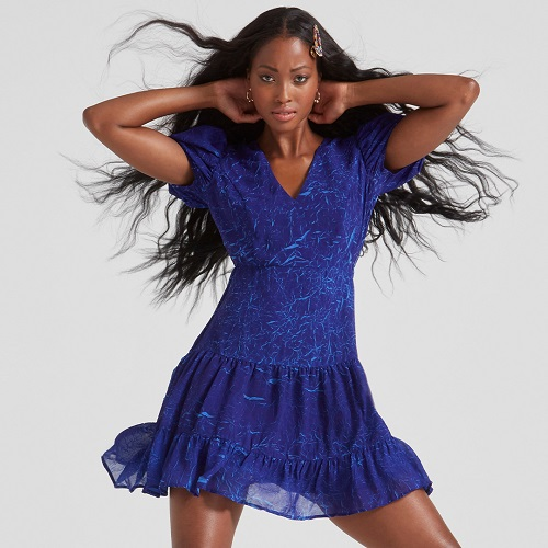 A woman wearing a bright blue dress.