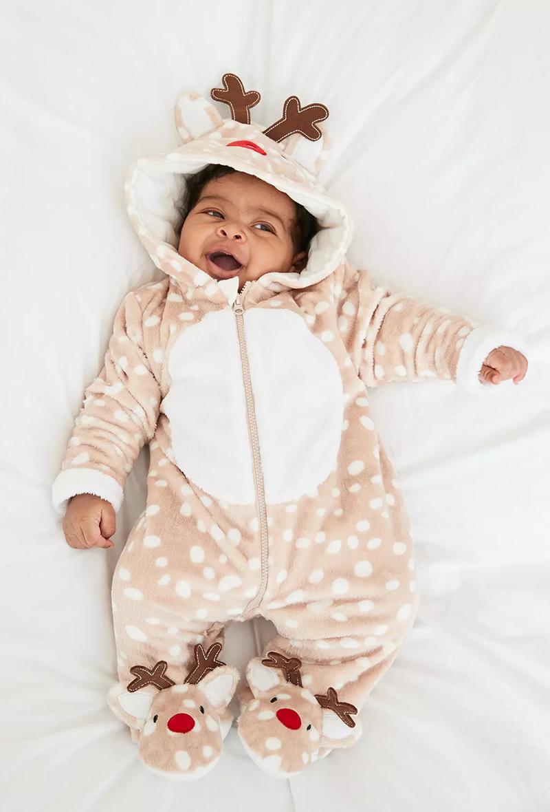 Baby wearing Christmas Primark Reindeer onesie