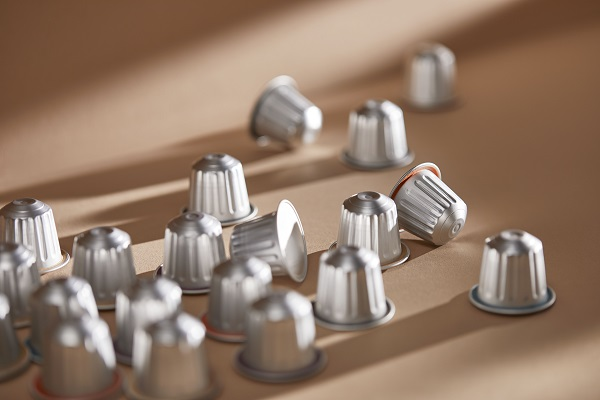 Close up of a number of silver coffee pods.