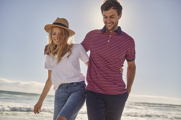 A woman wearing a white tee and denim shorts and a man wearing a striped tee.