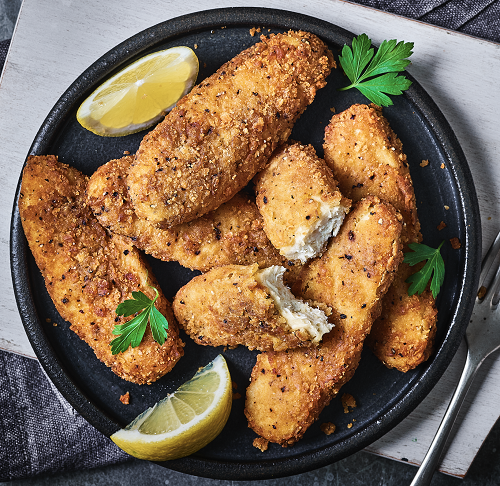 M&S southern fried tenders in a bowl with a slice of lemon.