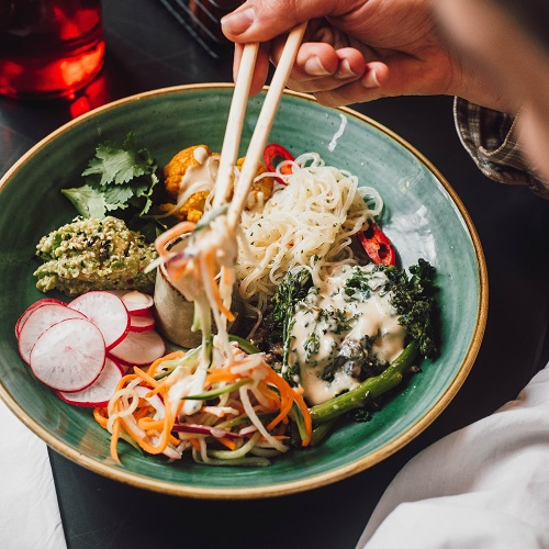 Hiyashi bowl- various wagamama food items with chopsticks