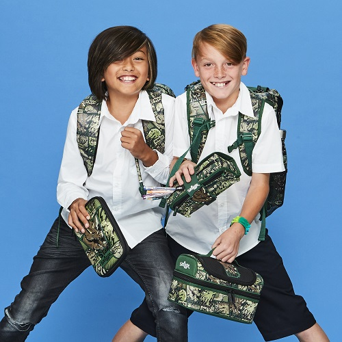Two boys wearing school uniform and smiggle back packs and pencil cases.