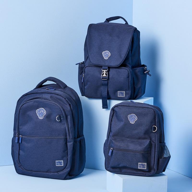 Three blue backpacks.