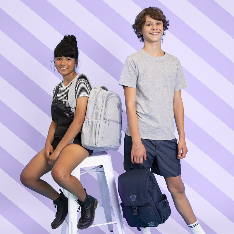 two people wearing a grey and a blue backpack.