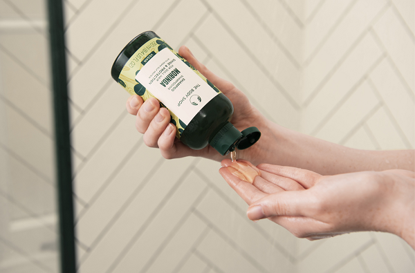 A bottle of Moringa haircare product from The Body Shop.
