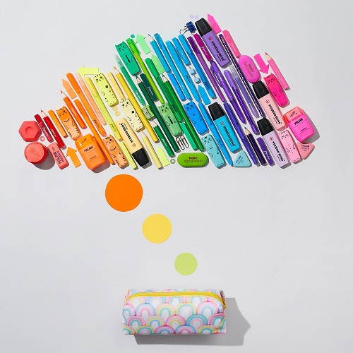colourful pens and pencils laid out to look like a cloud shape.