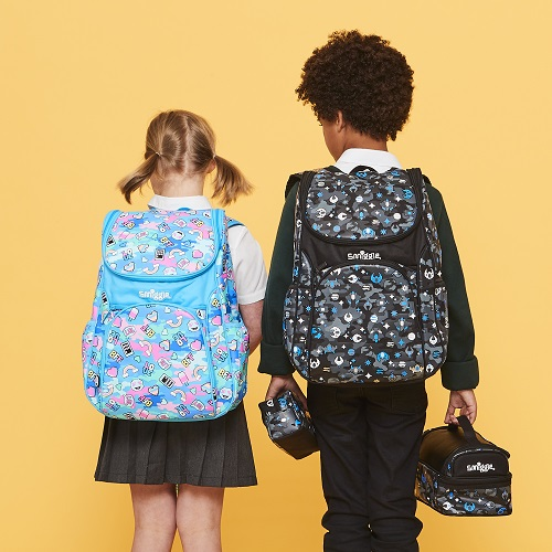 Two children wearing Smiggle back packs