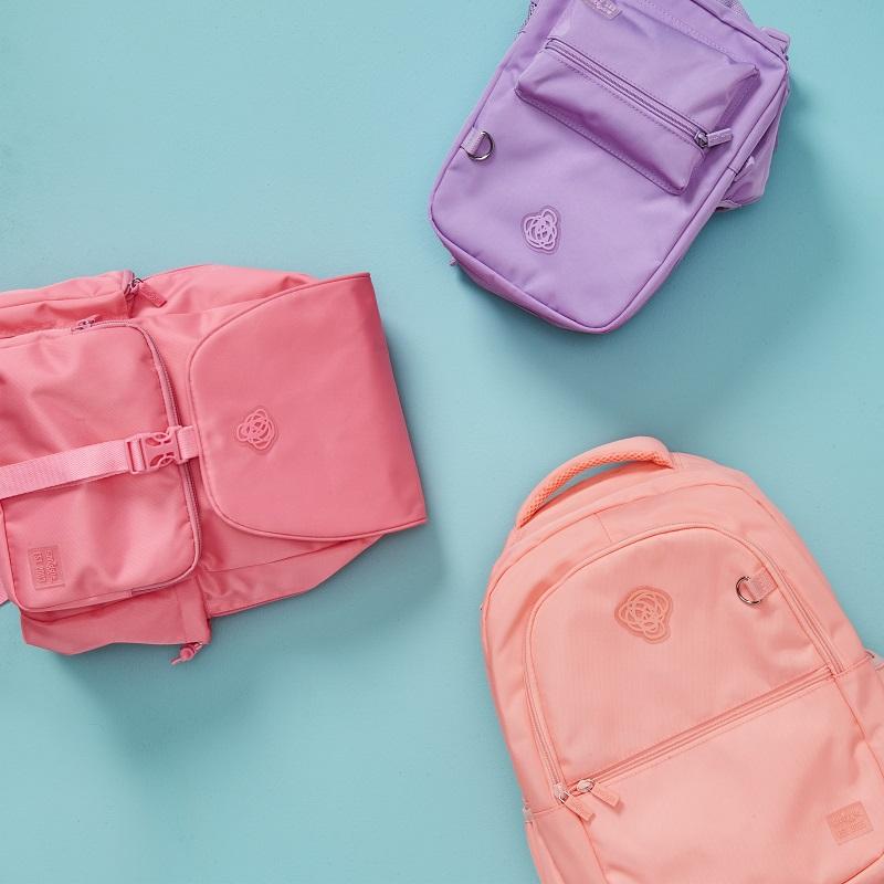 Three pastel coloured back packs.