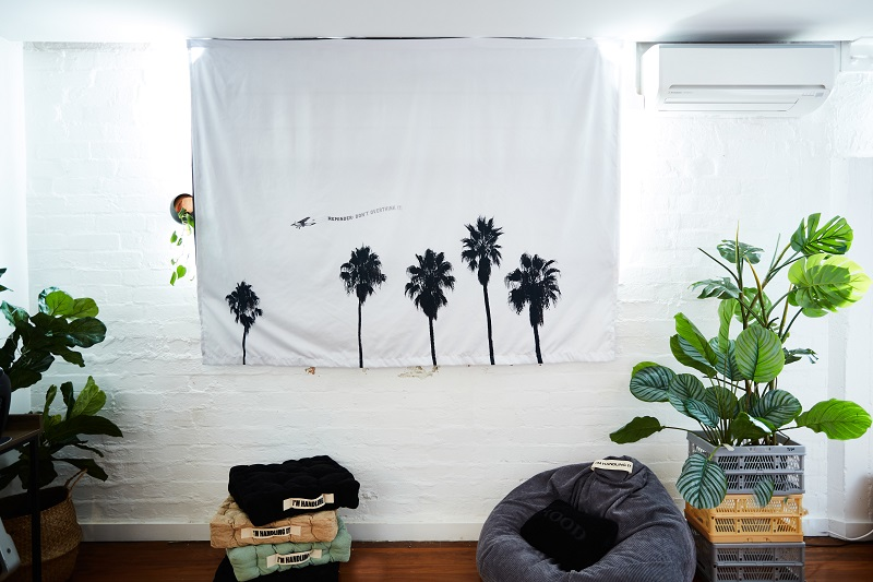 A backdrop on a wall with palm trees on it.