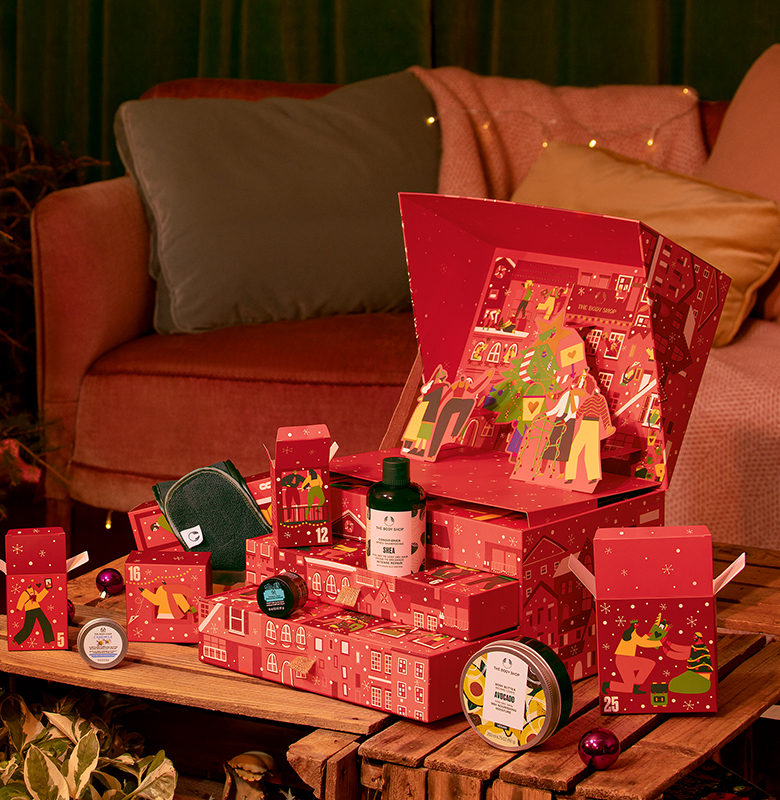 The Body Shop advent calendar (red) with products spilling out.