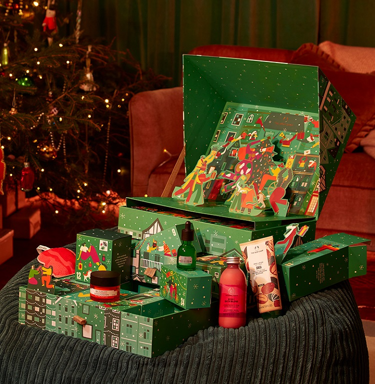 The Body Shop advent calendar (green) with products spilling out.