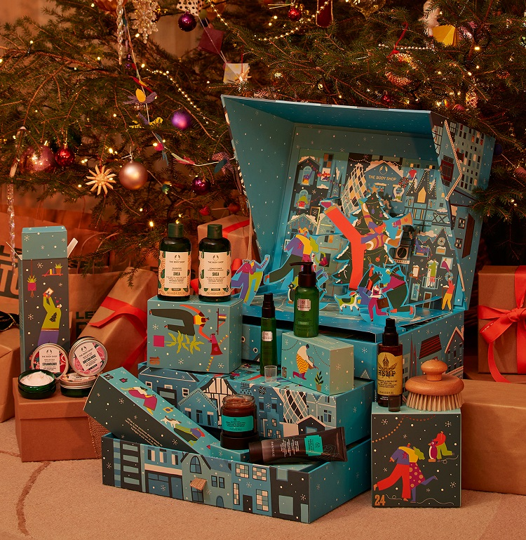 The Body Shop advent calendar (blue) with products spilling out.
