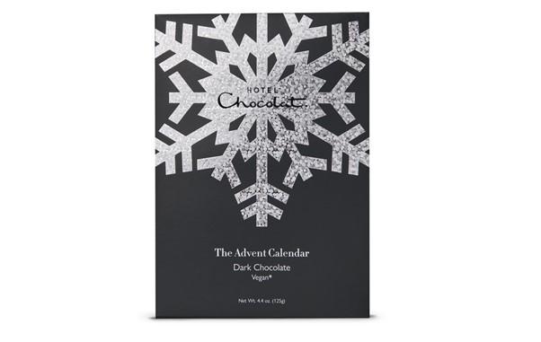Black Advent Calendar from Hotel chocolat with chocolates around it.
