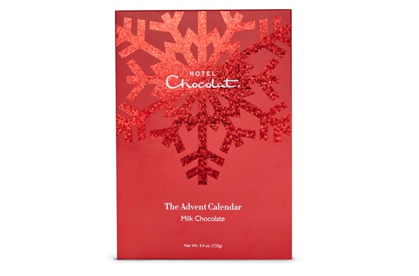 Red Advent Calendar from Hotel chocolat with chocolates around it.