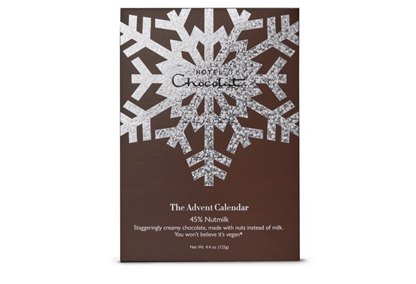 Brown Advent Calendar from Hotel chocolat with chocolates around it.