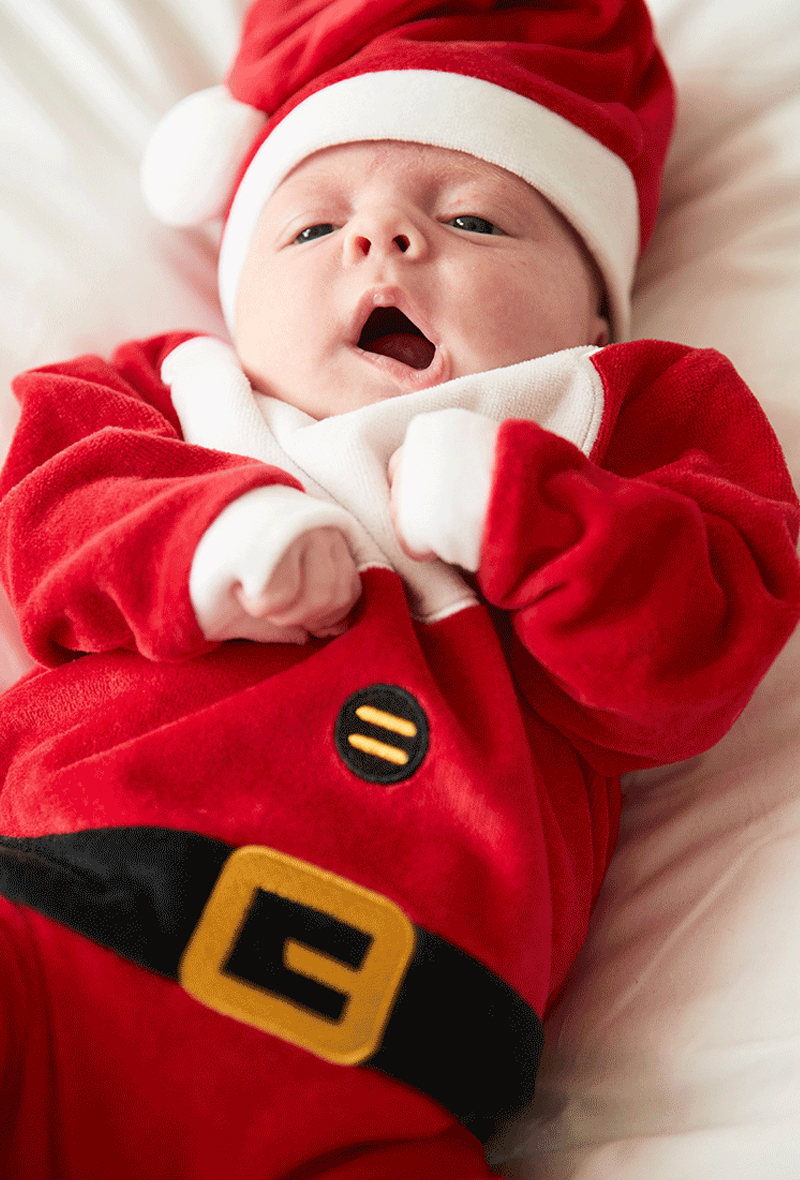 Baby wearing Christmas Primark Santa costume