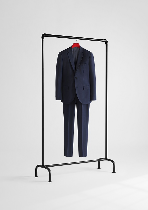 A blue suit hanging on a clothes rail.