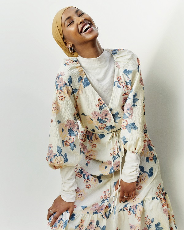 A woman wearing a floral maxi dress.