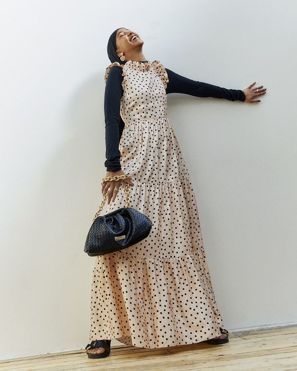 A woman wearing a polka dot maxi dress.