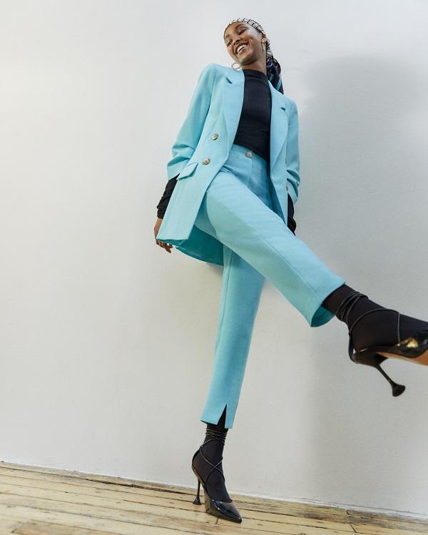 A woman wearing a blue suit.