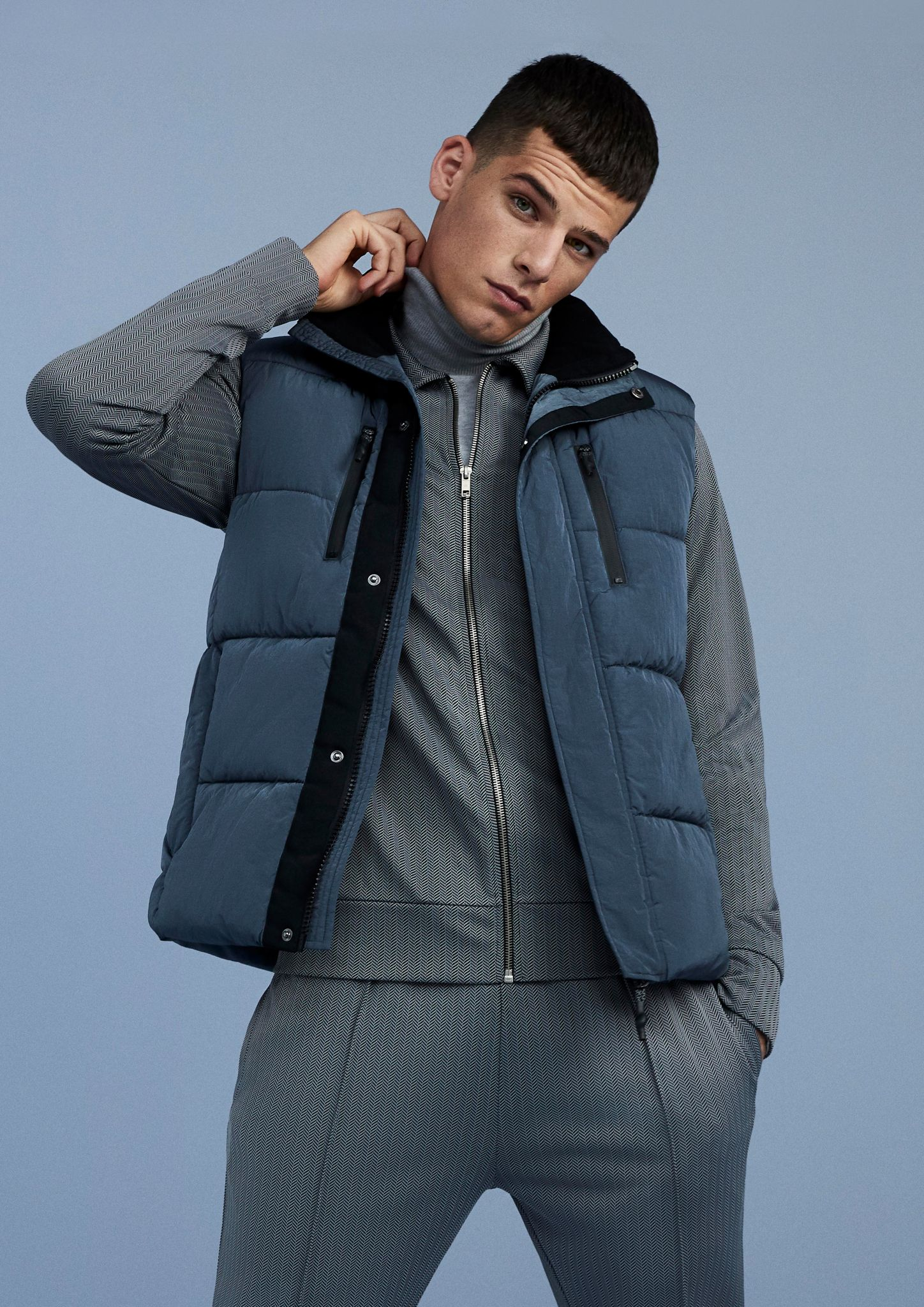 Male model wearing a tracksuit and a gilet jacket from River Island's new autumn collection