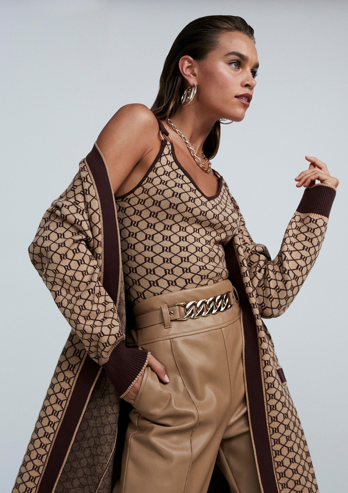 Female model for River Island showcasing tan coloured clothing from their Autumn collection