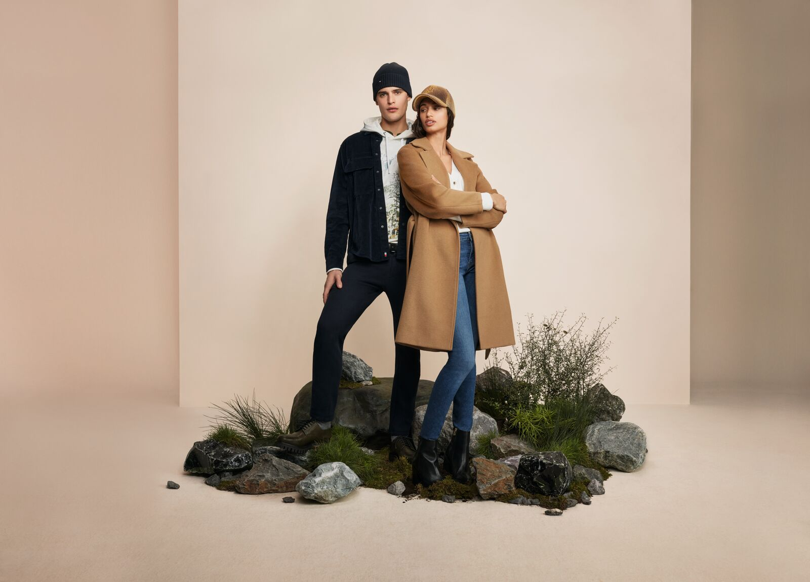 Male and female models wearing winter clothes from Tommy Hilfiger