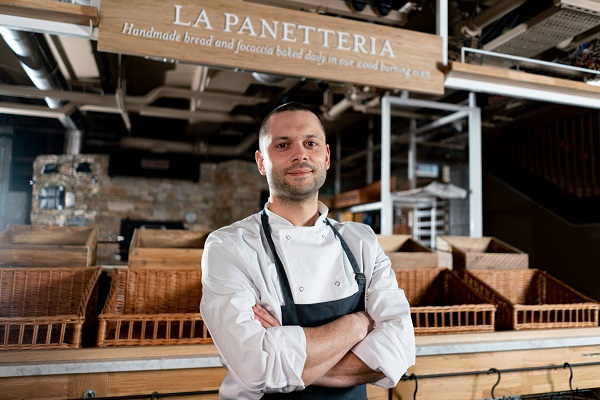 Eataly Chef in front of La Panetteria sign