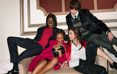 Four people wearing Gant clothes and all sitting on a couch.