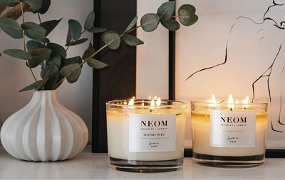 Two neom candles on a side.