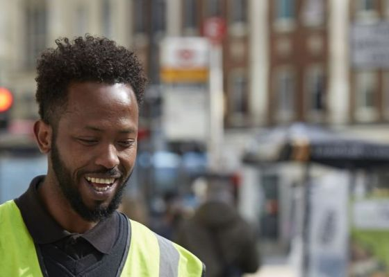 Image of a man working in London smiling