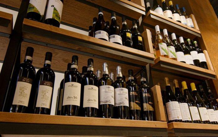 Shelves with wine bottles on.