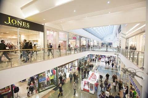 A photo of the mall at Drake Circus with people shopping.