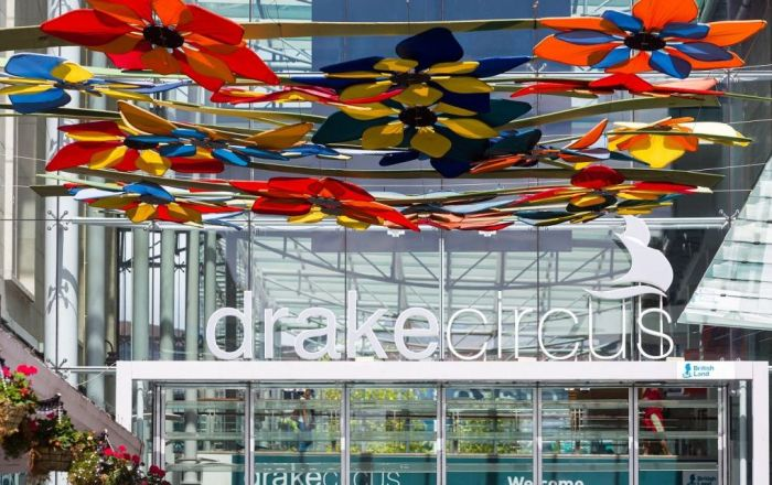 The entrance to Drake Circus with the colourful flower canopy in the foreground.