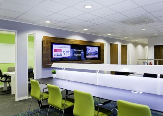 Meeting room in Regus with TV Screens and tables and chairs.