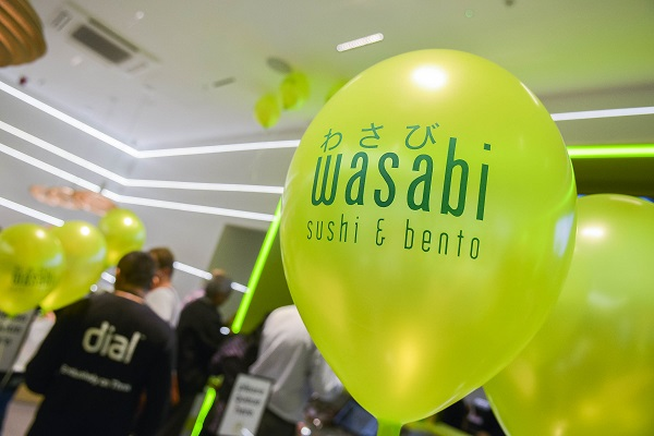 Neon yellow balloon labeled Wasabi sushi & bento