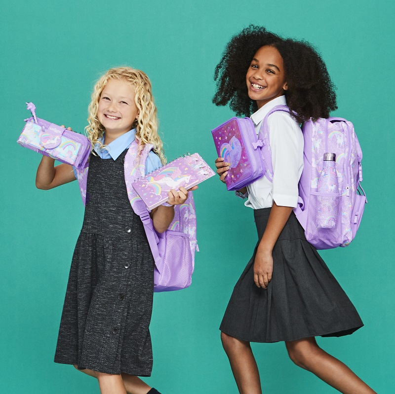Two school girls with Smiggle backpacks and accessories.