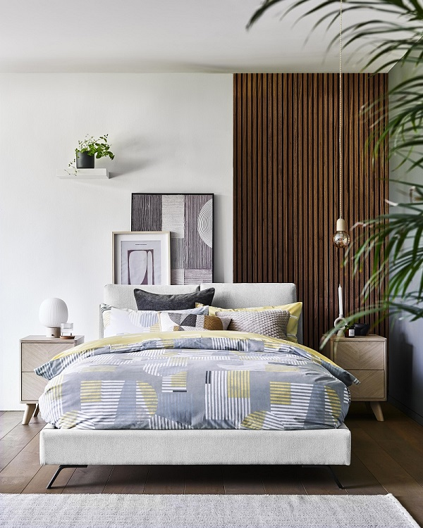 A bed with stripey bed sheets.