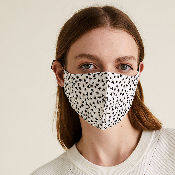 Woman wearing a printed mask from Marks & Spencer