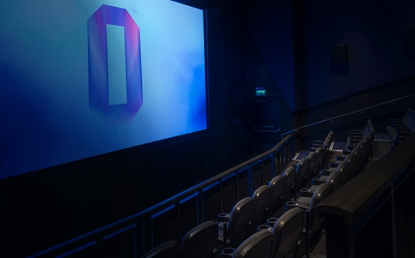 Interior of a cinema screen with a large 'O' on the screen.