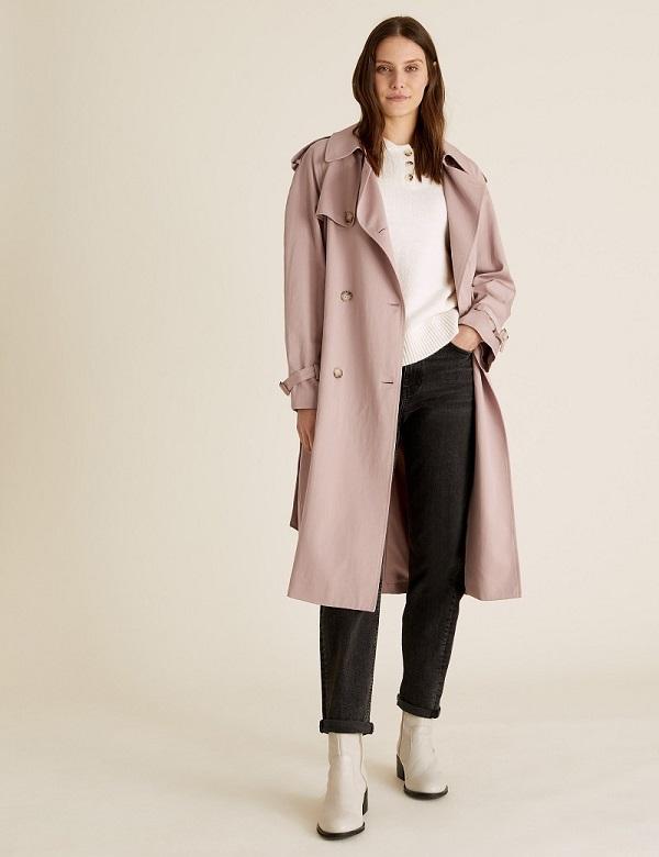 A woman wearing a long beige coat from M&S