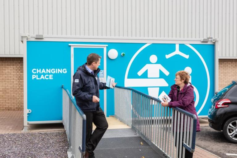 Picture of Liam Smith with Sarah Boyack at the Changing Places facility