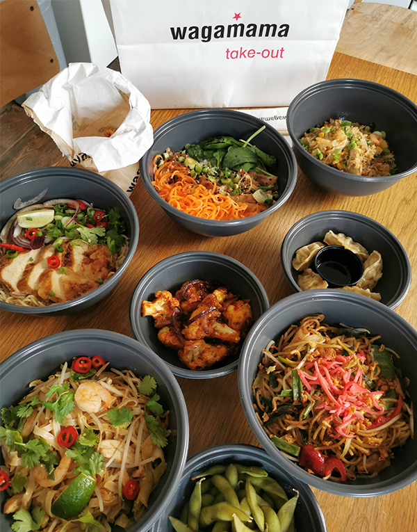 wagamama takeaway dishes in plastic bowls