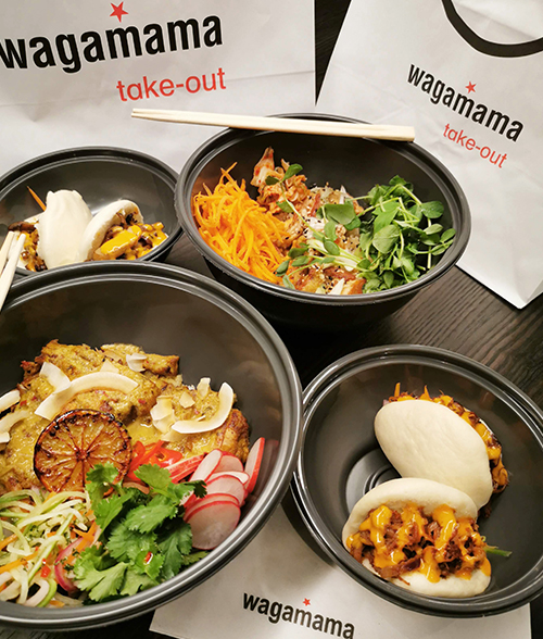 various dishes from wagamama in take-out bowls