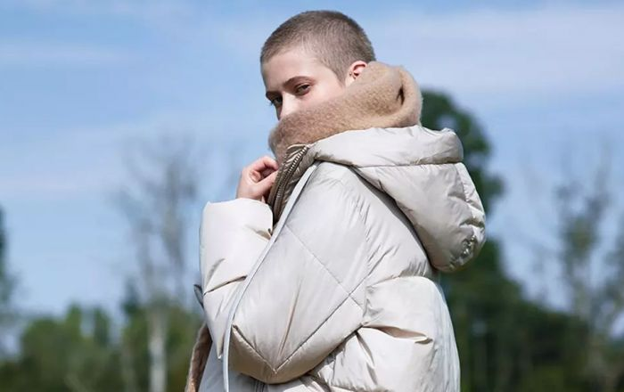 Primark model wearing a puffy beige coat for their autumn winter campaign