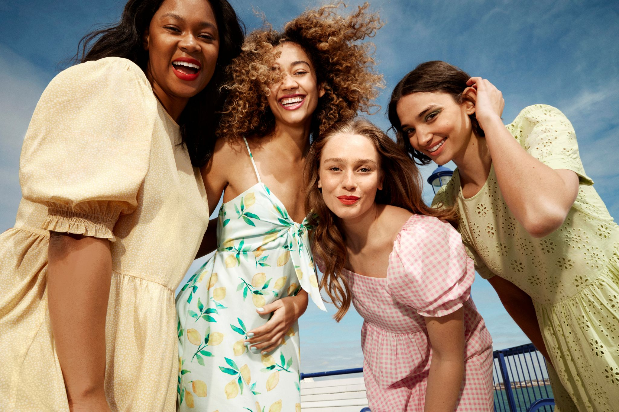 4 woman wearing dresses from New Look and smiling