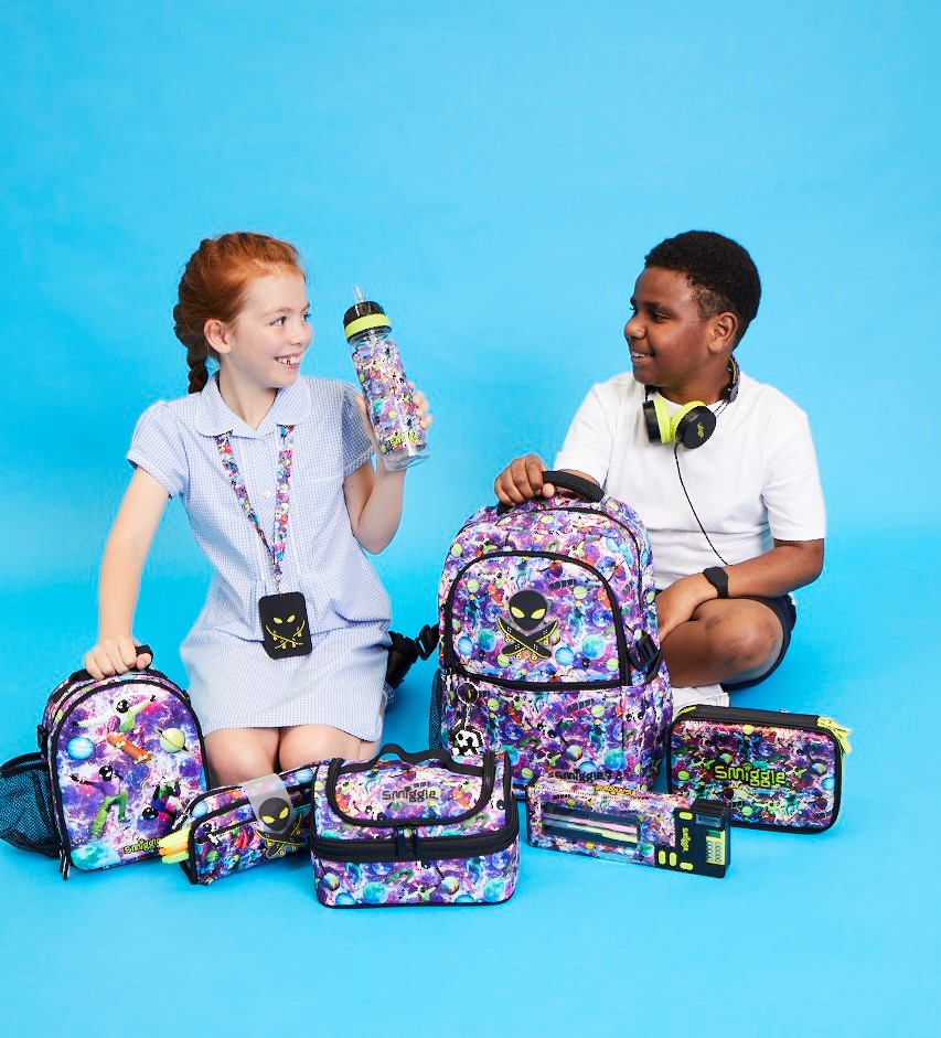 Two school children surrounded by colourful Smiggle bags.