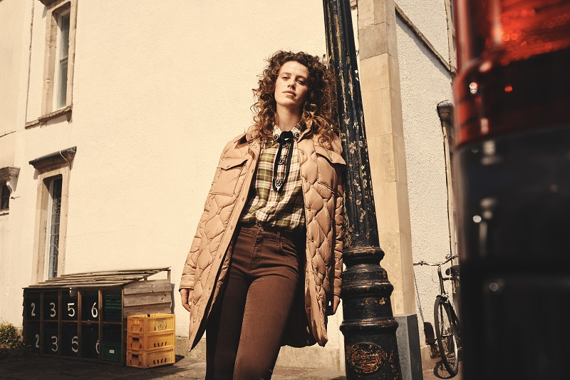 A model dressed in brown muted tones included a checked shirt.
