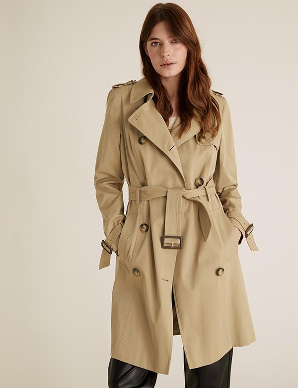 Woman wearing a mac coat from M&S